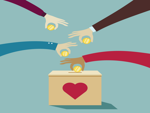 Hands placing money into a box.